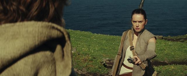 File:Rey hands Luke Skywalker his old lightsaber.png