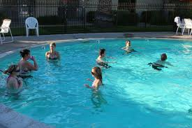 File:People in a pool.jpg