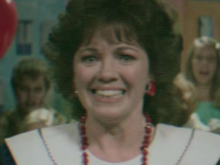 Edie Inksetter as Hostess