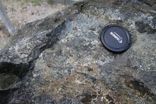 1280px-Basanite in Geopark on Albertov