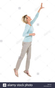 Active-senior-woman-jumping-up-and-reaching-out-on-white-background-FB6YNH