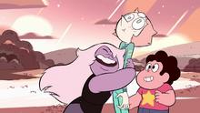 Amethyst happily hugs a surprised Pearl as Steven smiles.