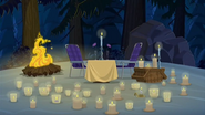 S1 E16 A table for two surrounded by many candles