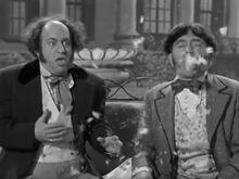 Moe & Larry stick by cake