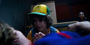 S03E07-Dustin trying to snap Steve out