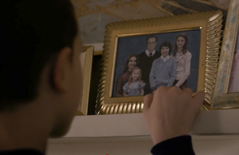 Eleven looks at the Wheeler family photo