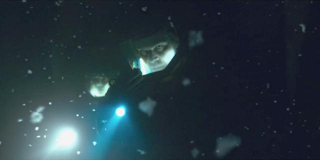 File:The Upside Down - Hopper in hazmat suit.png