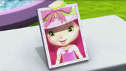 Strawberry admiring her hat in the mirror