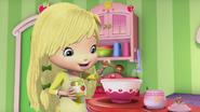 Lemon is adding some apple sauce to her batter