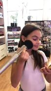 Ariana putting on makeup 2