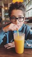 Nicolas drinking juice
