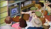 Kiki - people gather around the tv