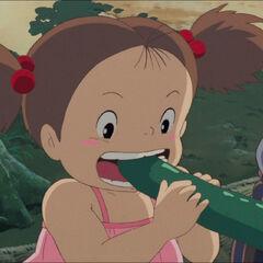 Mei tasting a cucumber