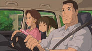 Chihiro and parents in car