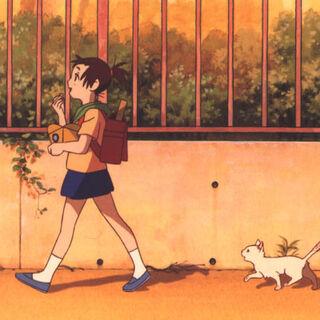 Yuki as a stray kitten, following Haru.