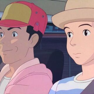 Taeko sits along with Toshio in his car