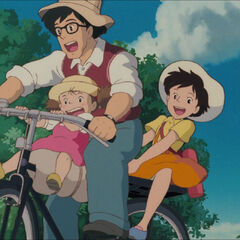Mei and Satsuki on their father's bicycle 1