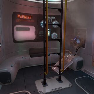 The Escape Pod houses a ladder to the upper exit, the Fabricator and a Storage unit