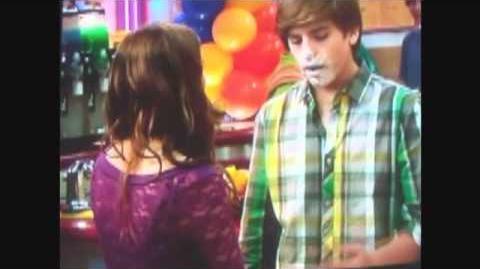 Zack and Maya kissing