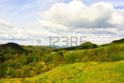 40922851-small-settlement-in-rural-area-in-highlands-of-scotland-uk-beautiful-cloudy-sky