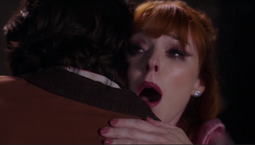 Sam hugging Rowena, stabbing her in the process