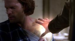 Castiel probing Sam's wound