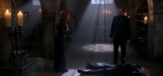 Rowena standing over Guthrie's corpse with Crowley (The Hunter Games)