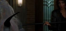 Billie killing Merle with her scythe