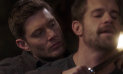 Dean putting a knife to Pax's throat