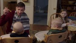Garth feeding his baby twins
