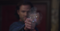 Sam shooting Lilith with a Devil's trap bullet