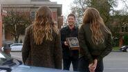 Dean holding the Black Grimoire
