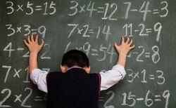 Boy-numbers-blackboard
