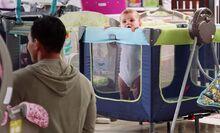 S01E01-Baby in playpen