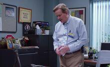S03E06-Glenn in office monkey puppet