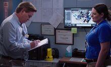 S03E06-Glenn Dina surveillance office