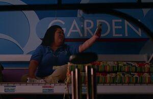 S01E09-Sandra on top of garden shelf