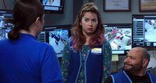 S02E18-Dina Cheyenne Garrett in surv office
