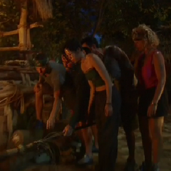 The Mogo Mogo tribe laying down Jenna M.'s torch (<i>unaired</i>).