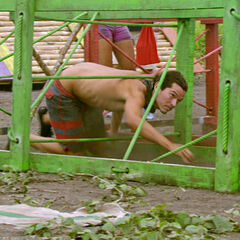 Jay attempts to crawl through one of the obstacles.