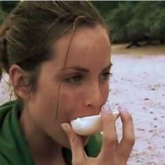 Danielle eating papaya.
