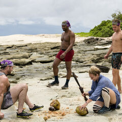 John with his tribemates on the beach.