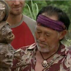 Bruce holding the Immunity Idol.