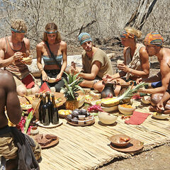 The merged tribe enjoying their feast.