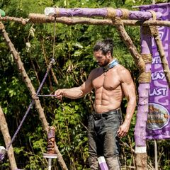John competing in <i>Ring Leader</i> for immunity.