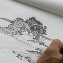 Bruce draws in his Luxury Item, a sketch book.