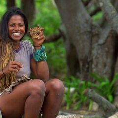 Natalie holding the Hidden Immunity Idol.