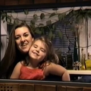 Laura on video with her daughter.