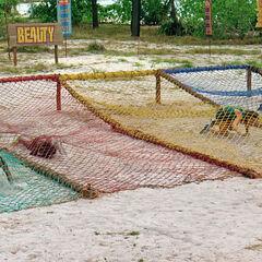 Dara crawling under the nets in <i><a href=
