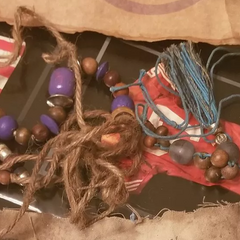 <i>Survivor: Heroes vs. Healers vs. Hustlers</i> Hidden Immunity Idol, a beaded string.